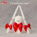 Три свечи украшены красными бантами - на стол молодоженов на банкете